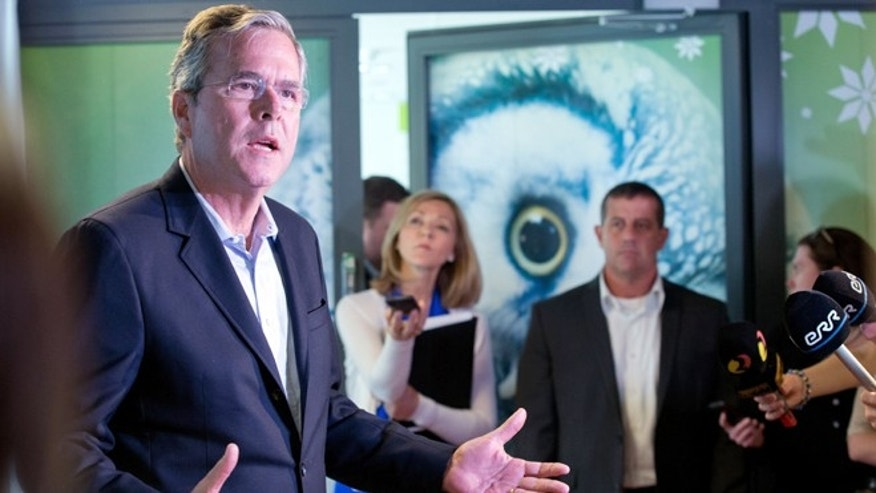 Former US Governor of Florida Jeb Bush speaks to journalists at the e- Estonia Showroom during his visit in Tallinn, Estonia, Saturday, June 13, 2015. Bush visits Estonia, a once-bleak Soviet state that now has a growing, free-market economy. If he was trying to stoke memories of his father and his legacy as president, Bush appears to have largely succeeded. (AP Photo/Liis Treimann)