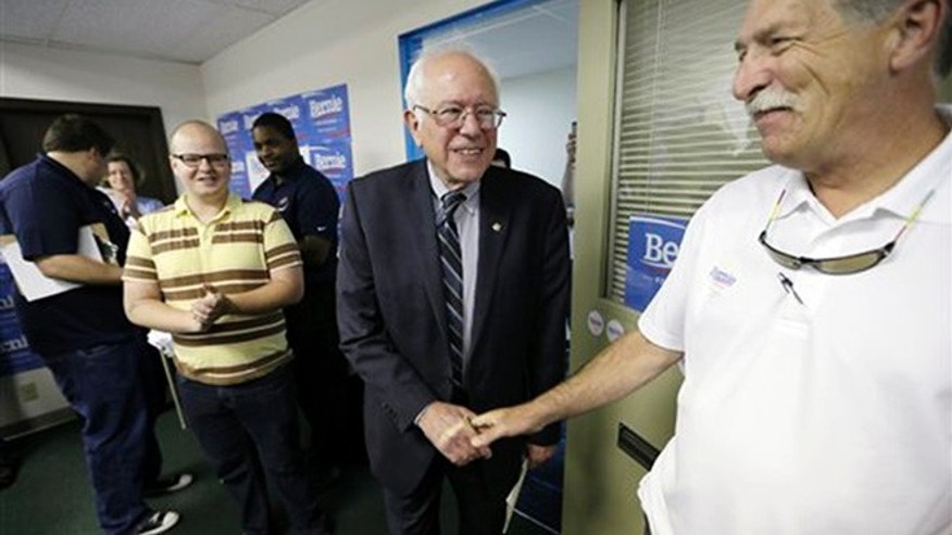 Democratic presidential candidate Sen. Bernie Sanders greets supporters at an open house at his Iowa campaign headquarters, Saturday, June 13, 2015, in Des Moines, Iowa. (AP Photo/Charlie Neibergall)