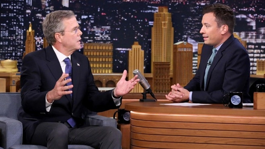 "Former Governor Jeb Bush, left, the new Republican presidential candidate, speaks during an interview with host Jimmy Fallon on ""The Tonight Show Starring Jimmy Fallon,"" Tuesday, June 16, 2015, in New York.  (Douglas Gorenstein/NBC via AP)"
