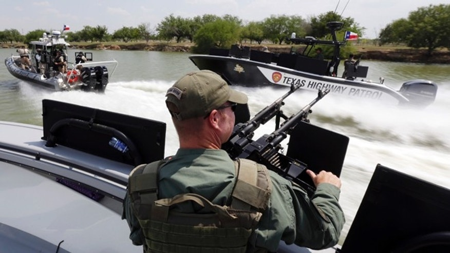 FILE - In this July 24, 2014 file photo, Texas Department of Safety Troopers patrol on the Rio Grand along the U.S.-Mexico border, in Mission, Texas. The states new Republican governor, Greg Abbott, this month approved $800 million for border security over the next two years,  more than double any similar period under 14 years of Perry, and by comparison, more than the state spends on environmental regulation. (AP Photo/Eric Gay, Pool, File)