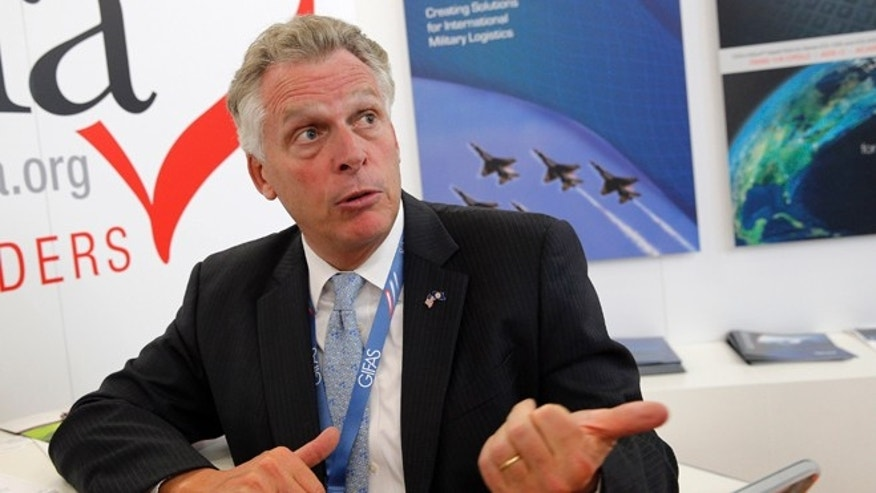 In this photo taken Tuesday June 16, 2015, Virginia Gov. Terry McAuliffe speaks during an interview with the Associated Press during the Paris Air Show, at Le Bourget airport, north of Paris. Governors across the country have been packing their bags for all-expenses-paid trade missions abroad, spending taxpayer dollars on costly trips that have an uneven track record of yielding any tangible benefits for their states. (AP Photo/Christophe Ena)