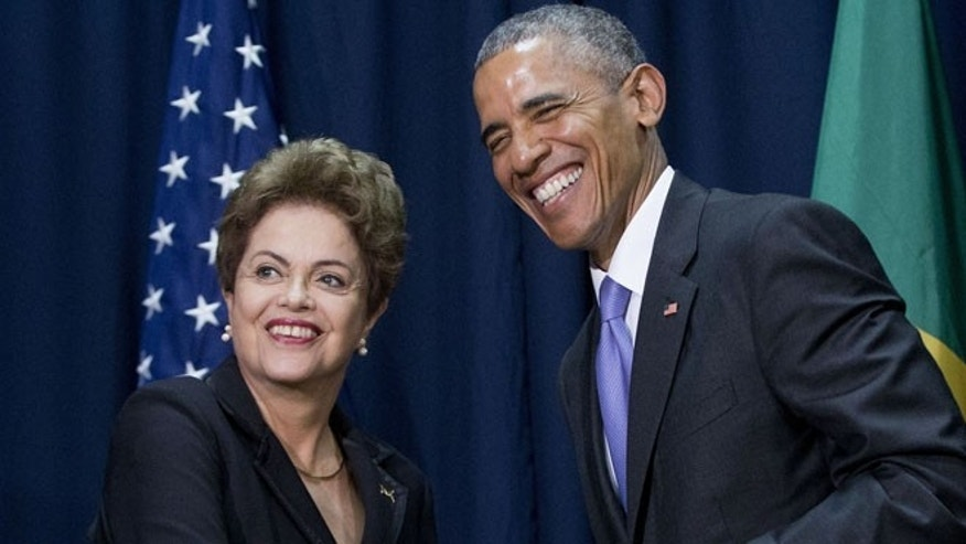 FILE - In this April 11, 2015, file photo, U.S. President Barack Obama, right, and Brazilian President Dilma Vana Rousseff shake hands during their bilateral meeting at the Summit of the Americas in Panama City, Panama. Rousseff visits Washington and will meet with Obama on June 29 and 30. (AP Photo/Pablo Martinez Monsivais, File)