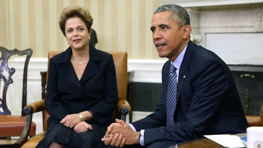 WASHINGTON, DC - JUNE 30: (AFP OUT) Brazilian President Dilma Rousseff (L) and U.S. President Barack Obama pose for photographs in the Oval Office at the White House June 30, 2015 in Washington, DC. Rousseff and Obama held meetings and a joint press conference almost two years after Rousseff accepted but then skipped an invitation to the White House due to revelations from former NSA contractor Edward Snowden that the U.S. had spied on Rousseff and other Brazilians.  (Photo by Chip Somodevilla/Getty Images)