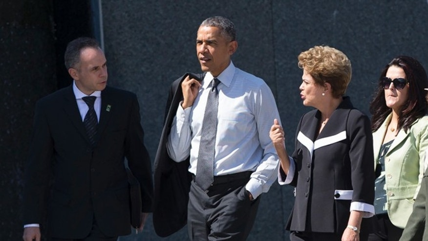 President Barack Obama walks with Brazilian President Dilma Rousseff , second from right, during a visit the Martin Luther King Jr. Memorial in Washington, Monday, June 29, 2015. (AP Photo/Evan Vucci)