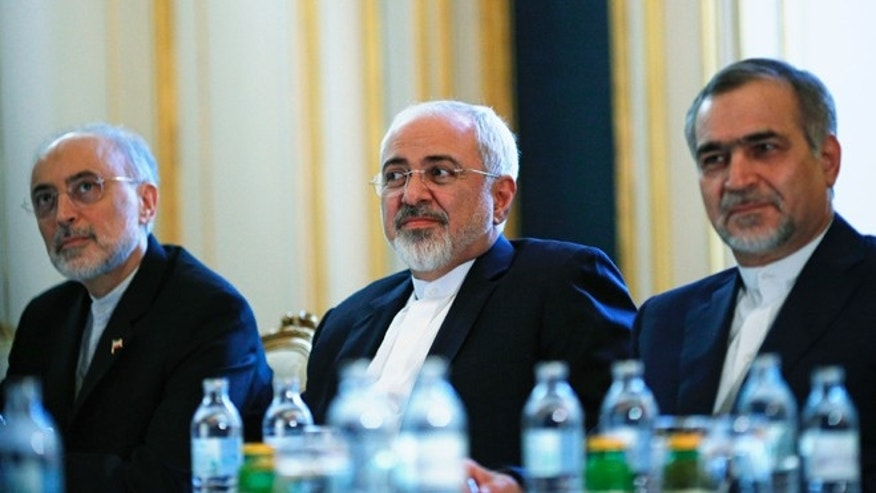 July 3, 2015: Iranian Foreign Minister Mohammad Javad Zarif, centre, Head of the Iranian Atomic Energy Organization Ali Akbar Salehi, left, and Hossein Fereydoon, brother and close aide to President Hassan Rouhani, meet with U.S. Secretary of State John Kerry in Vienna, Austria.