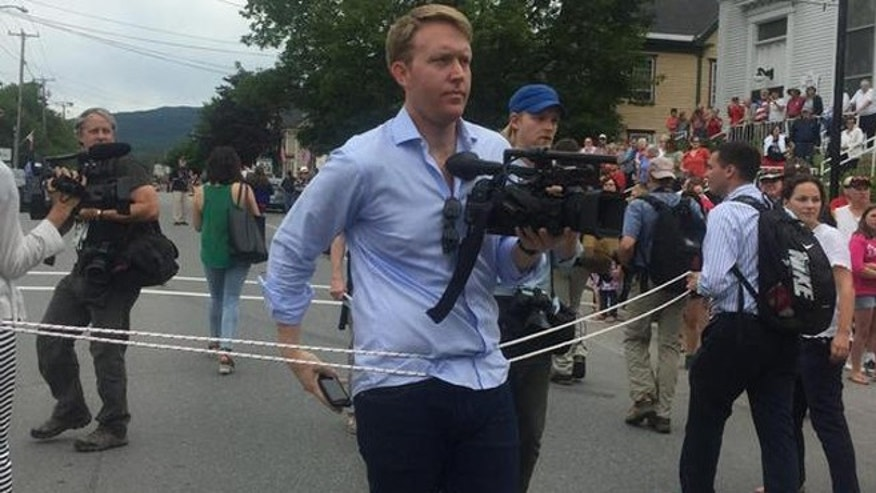 July 4, 2015: Cameramen roped off during Hillary Clinton campaign event in New Hampshire.