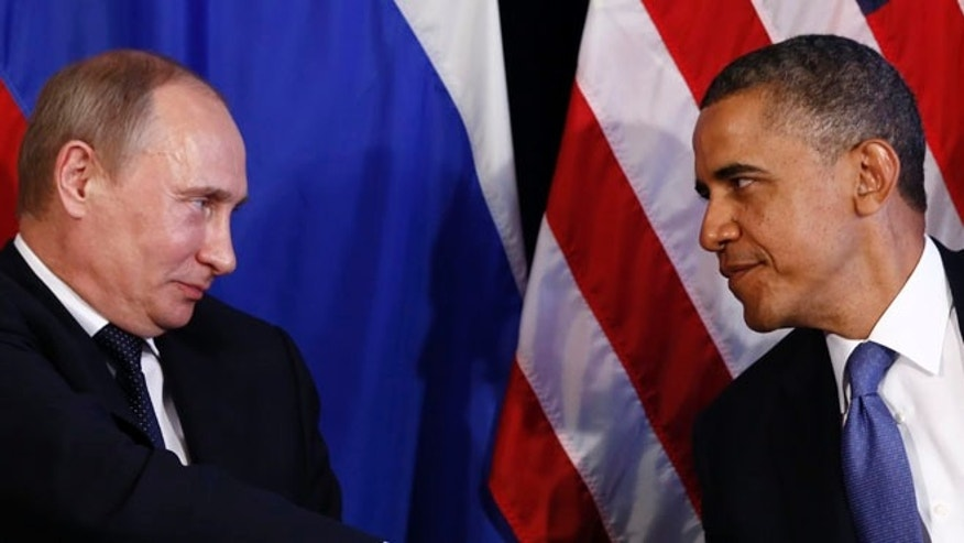 FILE: June 18, 2012: President Obama and Russian President Vladimir Putin, in Los Cabos, Mexico.