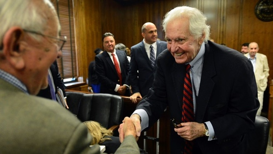 July 10, 2015: John Jay Hooker, right, is greeted after his hearing in Nashville, Tenn.