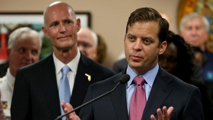 Florida Governor Rick Scott (L) looks on after introducing Carlos López-Cantera as his new lieutenant governor on January 14, 2014 in Miami, Florida. (Photo by Joe Raedle/Getty Images)