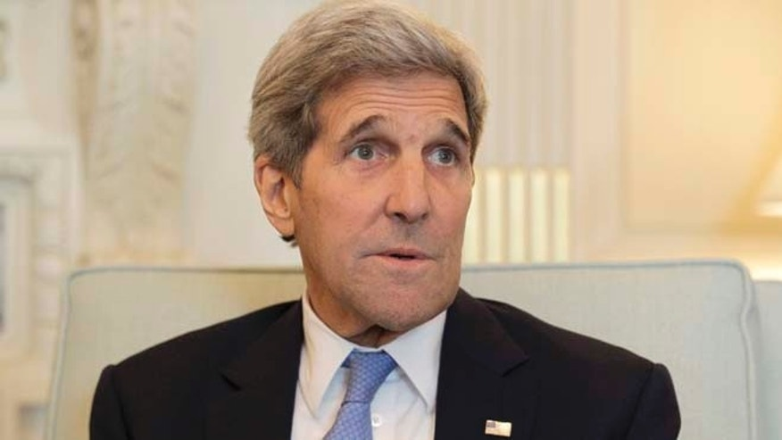July 15, 2015: Secretary of State John Kerry talks to reporters during a meeting at the State Department in Washington. (AP Photo/Luis M. Alvarez)