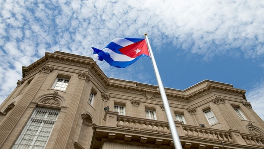 July 20, 2015: The Cuban flag is raised over their new embassy in Washington.