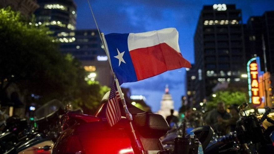 June 12, 2015: A Texas state flag attached to a bike waves after the Republic of Texas (ROT) Biker Rally parade in Austin, Texas.