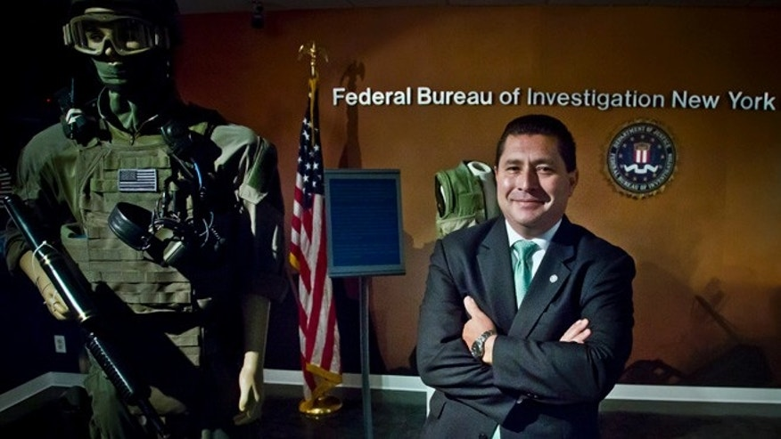 Diego Rodriguez, assistant FBI director in charge the New York field office, poses outside his office, Wednesday, July 15, 2015, in New York. Rodriguez oversees all operations and personnel in the five boroughs of New York City, eight counties in New York state, and La Guardia Airport and John F. Kennedy International Airport. (AP Photo/Bebeto Matthews)