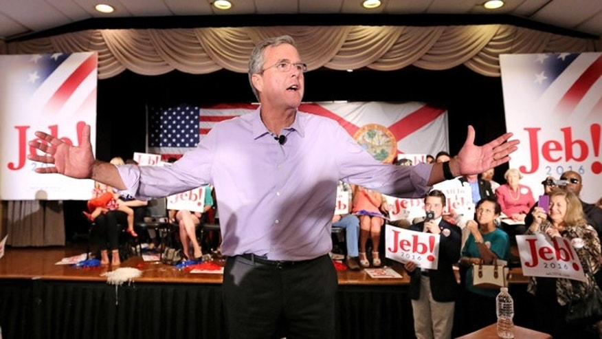 2016 Republican presidential candidate Jeb Bush responds to cheering supporters during a campaign rally at the Maitland Venue in Maitland, Fla., Monday, July 27, 2015. (Joe Burbank/Orlando Sentinel via AP) MAGS OUT, NO SALES MANDATORY CREDIT
