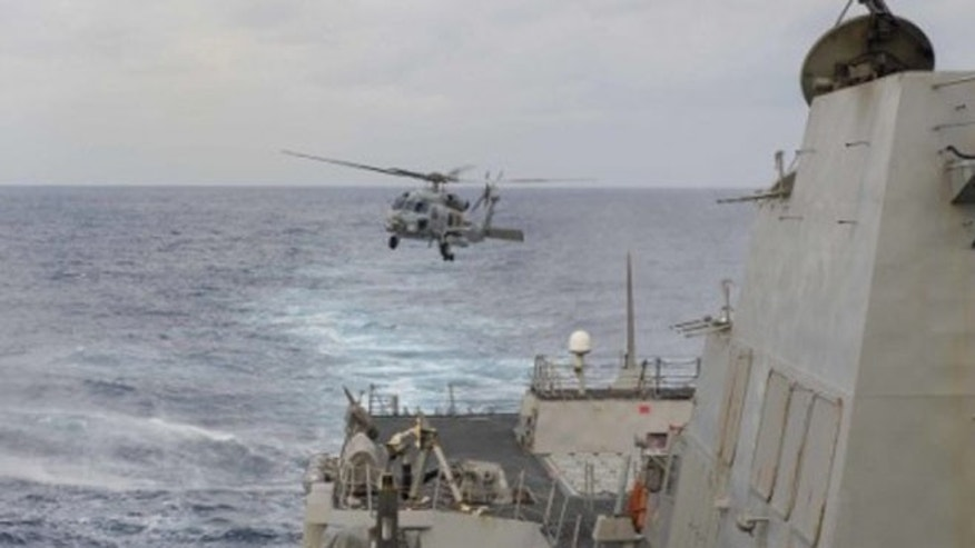 Feb 4: 2015: An MH-60R Seahawk helicopter assigned to Helicopter Maritime Strike Squadron 46 'Grandmasters' takes off from the Arleigh Burke-class guided-missile destroyer USS Farragut. (US Navy)