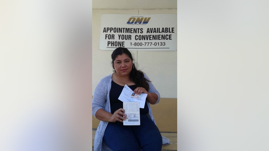 Carmela Gonzalez shows her new driver's license.