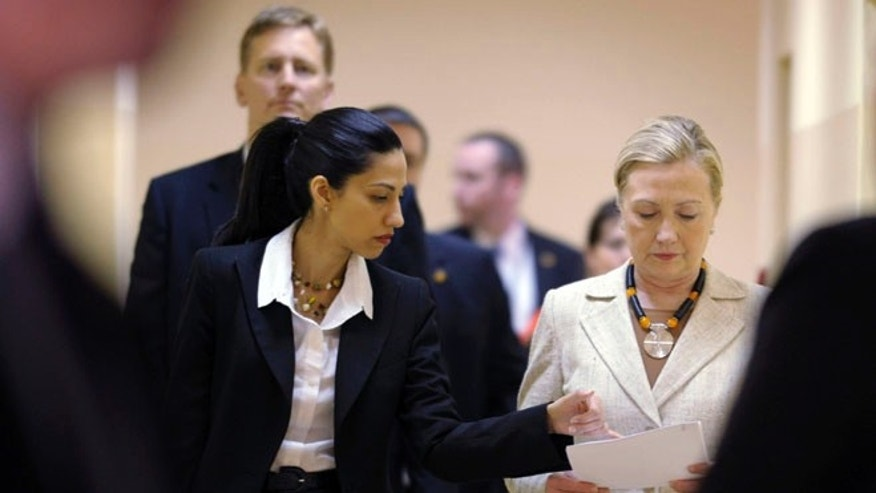 FILE: June 11, 2011: Huma Abedin with then-Secretary of State Hillary Clinton, Lusaka, Africa.