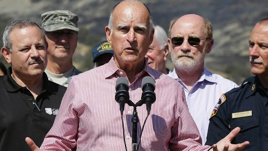 Aug 6, 2015: Gov. Jerry Brown, center, speaks next to Mark Ghilarducci, director of the California Governors Office of Emergency Services, left, and Cal Fire Chief Ken Pimlott, right, at a news conference at Cowboy Camp Trailhead near Clearlake, Calif.