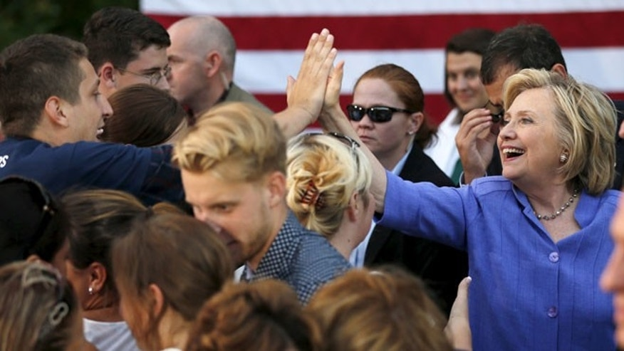 Aug 10, 2015: U.S. Democratic presidential candidate Hillary Clinton high-fives a supporter at a campaign stop in Manchester, New Hampshire. (Reuters)