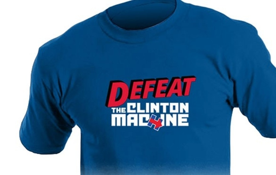 "The former Arkansas governor gets in on the act with a comic-book style T-shirt, labeled  ""Defeat the Clinton machine"" ($19)."