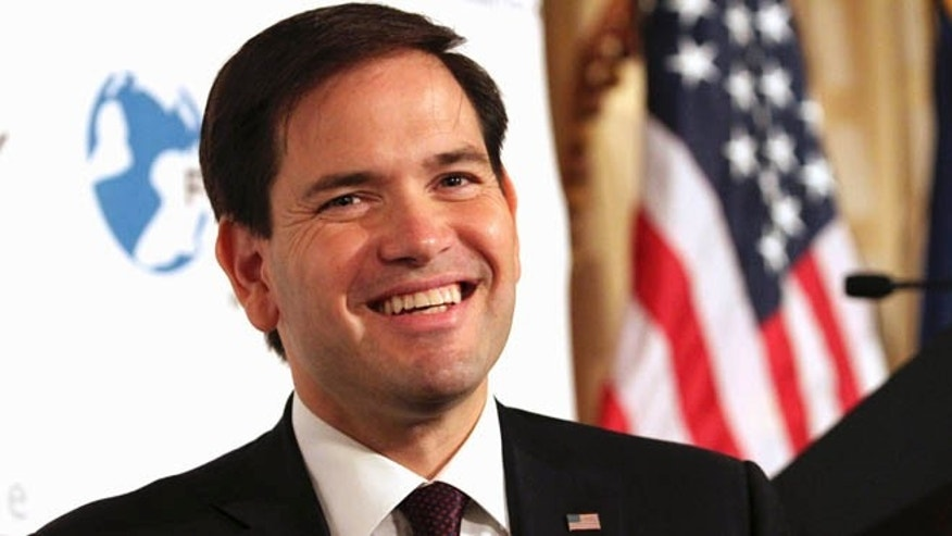 In this Friday, Aug. 14, 2015, photo, Republican presidential candidate, Sen. Marco Rubio, R-Fla. smiles while speaking during an event hosted by the Foreign Policy Initiative in New York. Rubioâs slow-go campaign strategy is puzzling party operatives in Iowa and New Hampshire, states where voters are used to candidates showering them with attention early and often. (AP Photo/Tina Fineberg)