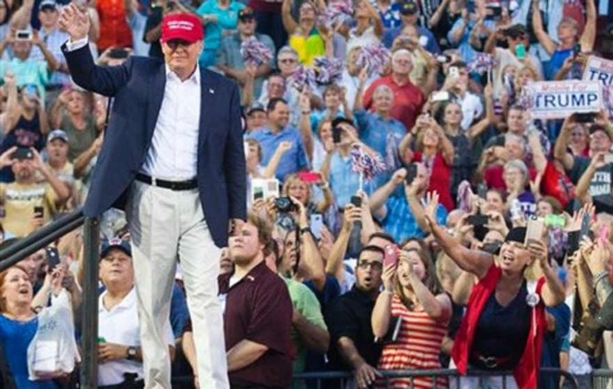 Aug 21., 2015: Republican presidential candidate Donald Trump waves to supporters during a campaign rally in Mobile, Ala.