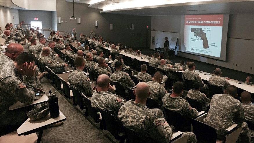 Aug. 3, 2015: Members of the Indiana Nation Guard undergo National Rifle Association firearm training in the auditorium of the Johnson County Armory in Franklin, Ind.