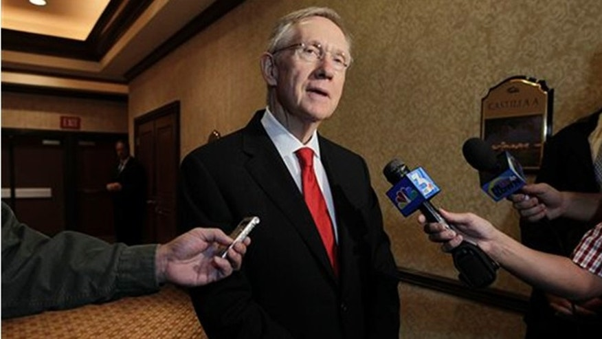 This Aug. 25, 2010 file photo U.S. Sen. Majority Leader Harry Reid answers questions for a member of the media in Las Vegas, Nev.(AP Photo/Julie Jacobson,File)