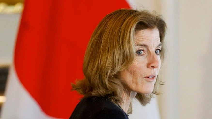 Nov. 14, 2015: U.S. Ambassador Caroline Kennedy walks past the Japanese flag during a reception of Major League Baseball (MLB) players at the ambassador's residence in Tokyo. (Reuters)