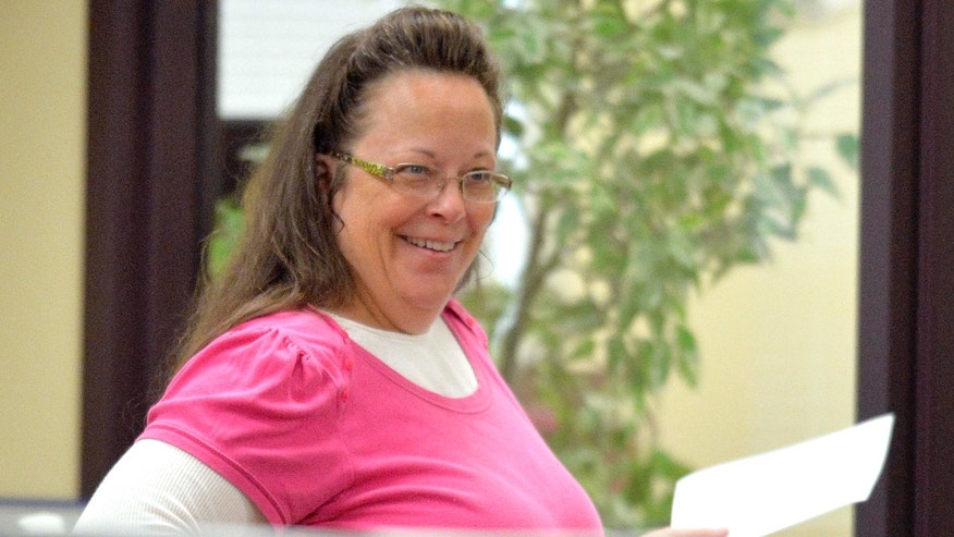 Aug. 18, 2015: Rowan County Clerk Kim Davis smilesas she helps a customer at the Rowan County Courthouse in Morehead, Ky.