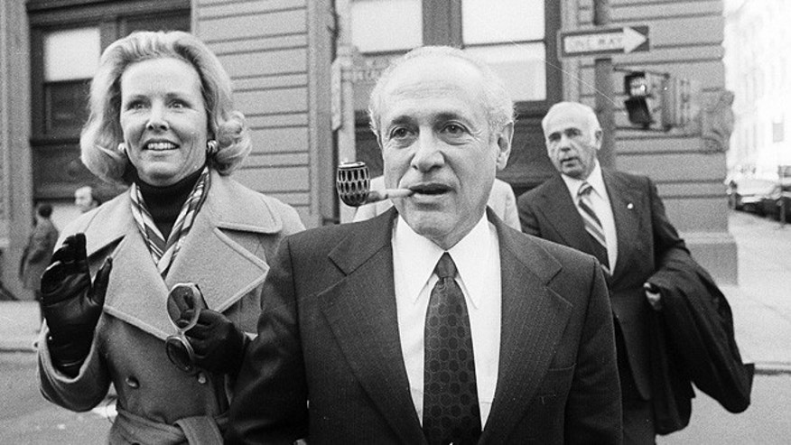 File-This Oct. 6, 2001, file photo shows Gov. Marvin Mandel, accompanied by his wife, Jeanne, walking to the federal courthouse in Baltimore.