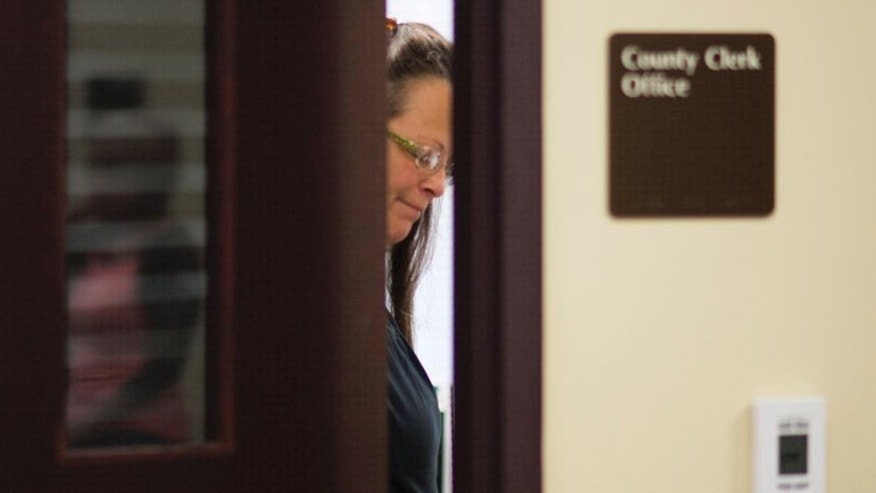 Kim Davis, the Rowan County Clerk of Courts, closes the door to her office after denying a marriage license to Robbie Blankenship and Jesse Cruz at the County Clerks Office on September 2, 2015 in Morehead, Kentucky. Citing a sincere religious objection, Davis, an Apostolic Christian, has refused to issue marriage licenses to same sex couples in defiance of a Supreme Court ruling. (Photo by Ty Wright/Getty Images)