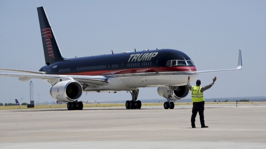July 23, 2015: Republican presidential candidate Donald Trump arrives on his signature plane in Laredo, Texas.