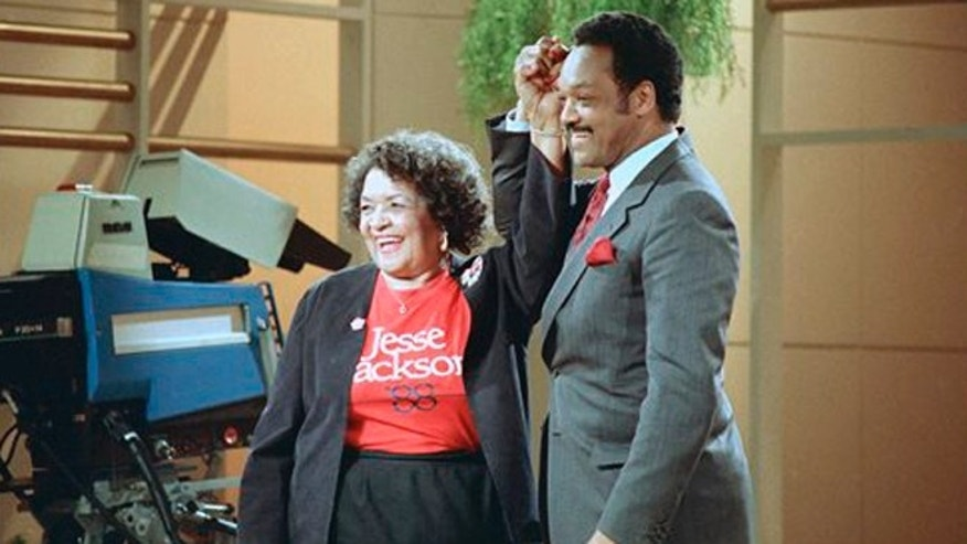 File:  Democratic presidential hopeful Jesse Jackson clasps hands with his mother, Helen Jackson, during taping of the Phil Donahue show in New York.