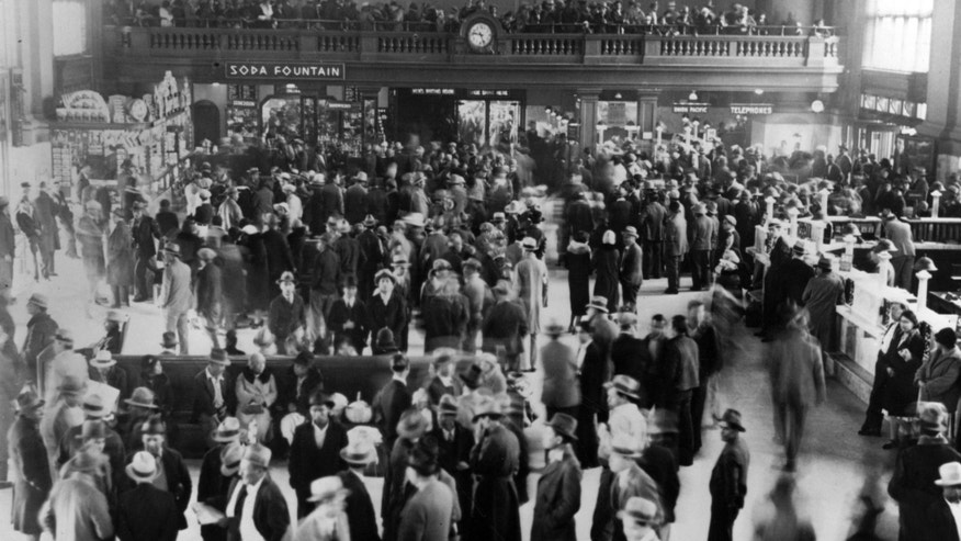This 1932 photo from the Los Angeles Herald Examiner Collection of the Los Angeles Public Library shows hundreds of Mexicans at a Los Angeles train station awaiting deportation to Mexico. Republican presidential candidate Donald Trump's call for mass deportation of millions of immigrants living in the U.S. illegally, as well as their American-born children, bears similarities to a large-scale removal that actually happened to many Mexican-American families 85 years ago. (Los Angeles Herald Examiner Collection/Los Angeles Public Library via AP)