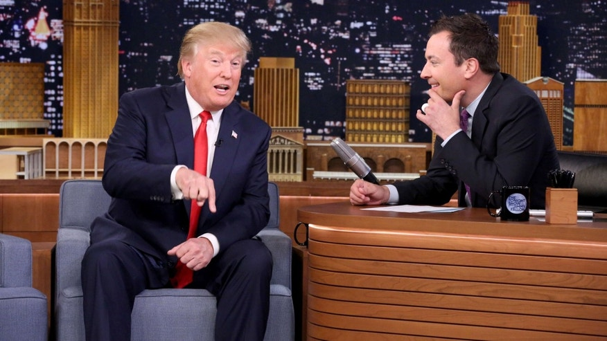 "Sept. 11, 2015: In this image released by NBC, Republican presidential candidate Donald Trump, left, appears with host Jimmy Fallon during a taping of ""The Tonight Show Starring Jimmy Fallon,"" in New York."