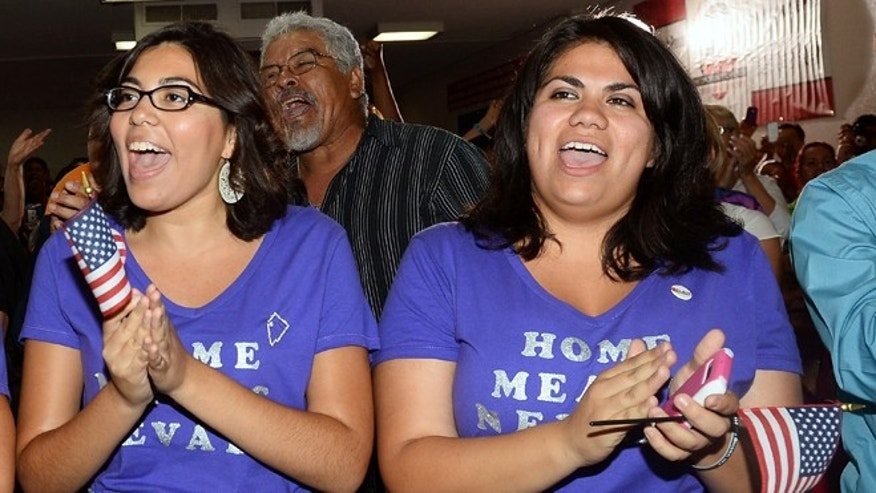 Blanca Gamez (L) and Astrid Silva, both from Nevada, cheer at an immigration reform event at the offices of the Culinary Workers Union Local 226. (Photo by Ethan Miller/Getty Images)