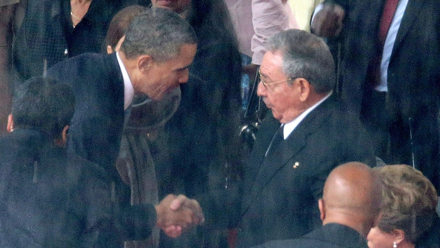 U.S. President Barack Obama (L) shakes hands with Cuban President Raul Castro during the official memorial service for former South African President Nelson Mandela.  (Photo by Chip Somodevilla/Getty Images)