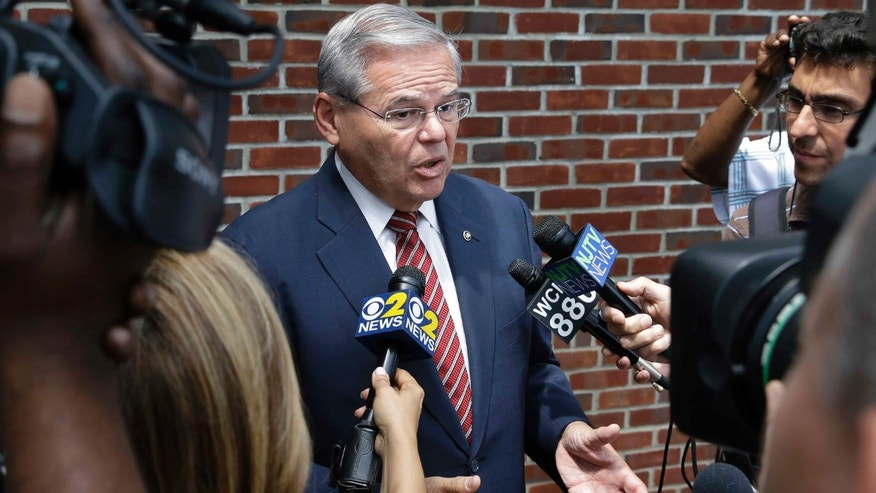FILE - In this July 27, 2015 file photo, Sen. Robert Menendez, D-N.J. speaks to reporters in Union Township, N.J. Attorneys for Menendez argued in court Thursday that the corruption case against him should be dismissed because the grand jury that indicted him was biased, prosecutors used hearsay evidence and salacious material was presented to inflame jurors. (AP Photo/Mel Evans, File)