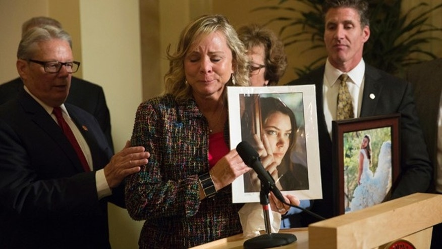 FILE - In this Sept. 11, 2015 file photo, Debbie Ziegler, mother of Brittany Maynard, speaks to the media after the passage of legislation, which would allow terminally ill patients to legally end their lives, at the state Capitol in Sacramento, Calif. (AP Photo/Carl Costas, File)