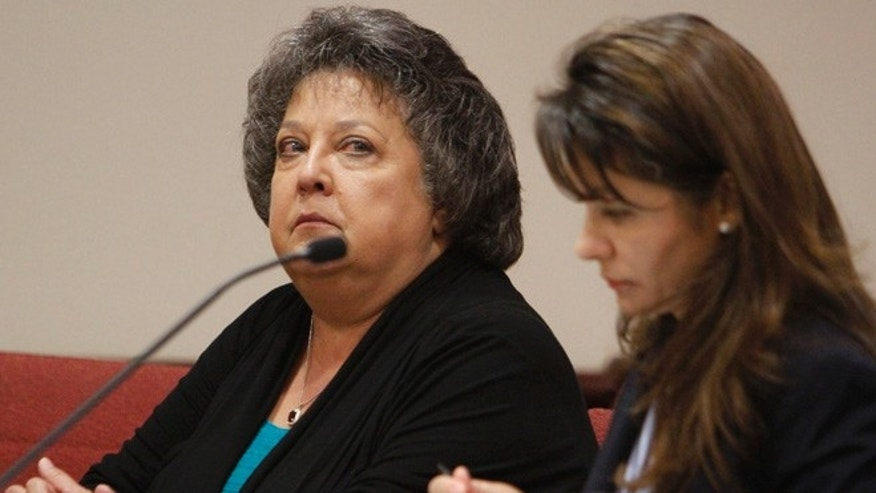 Sept. 15, 2015: New Mexico Secretary of State Dianna Duran, left, sits in Judge T. Glenn Ellington's court with her attorney, Erlinda Johnson in Santa Fe,(AP)