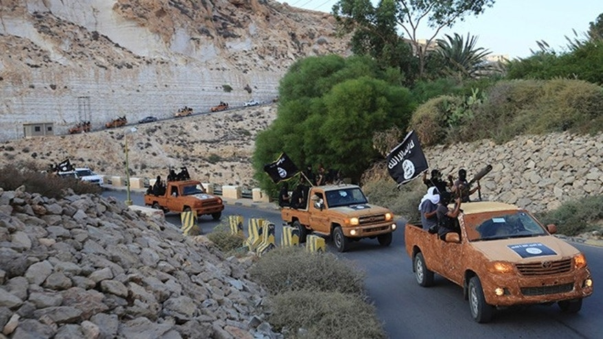 Oct. 3, 2014: An armed motorcade belonging to members of Derna's Islamic Youth Council, consisting of former members of militias from the town of Derna, drive along a road in Derna, eastern Libya. The group pledged allegiance to the Islamic State on October 3, 2014 local media reported.