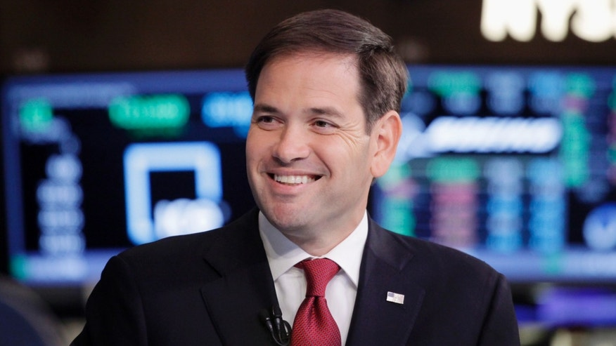 Republican presidential candidate, Sen. Marco Rubio, R-Fla., smiles during an interview with CNBC correspondent John Harwood at the New York Stock Exchange in New York, Monday, Oct. 5, 2015. (AP Photo/Mark Lennihan)