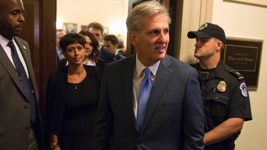 House Majority Leader Kevin McCarthy walks out of nomination vote meeting on Capitol Hill in Washington, Oct. 8, 2015.