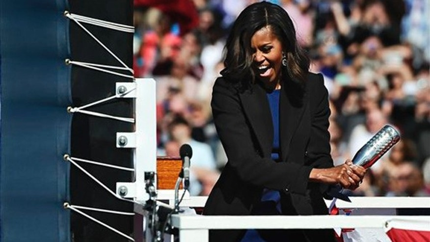 Oct. 10, 2015: First lady Michelle Obama christens the USS Illinois with a bottle of sparkling wine at Electric Boat, a division of General Dynamics, shipyard in Groton, Conn.