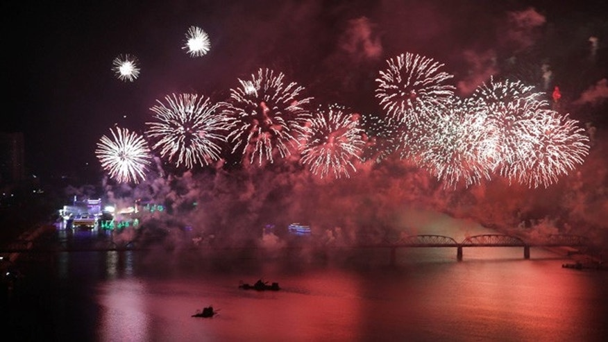 Oct. 12, 2015: Fireworks explode over the Taedong River as part of 70th anniversary celebrations of the founding of the ruling Workers' Party in Pyongyang, North Korea. (AP)