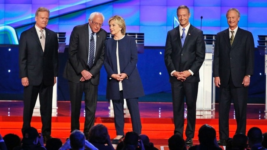 In this Oct. 13, 2015, photo, Democratic presidential candidates from left, former Virginia Sen. Jim Webb, Sen. Bernie Sanders, I-Vt., Hillary Rodham Clinton, former Maryland Gov. Martin O'Malley, and former Rhode Island Gov. Lincoln Chafee take the stage before the CNN Democratic presidential debate in Las Vegas. For the Democrats running for the White House, President Barack Obama has at times been a source of considerable discontent. During the they took positions ranging from warm embrace to polite disagreement. Compare that with the public bickering among Republican presidential candidates and the recent history of how parties have dealt with passing control of the White House. (AP Photo/John Locher)