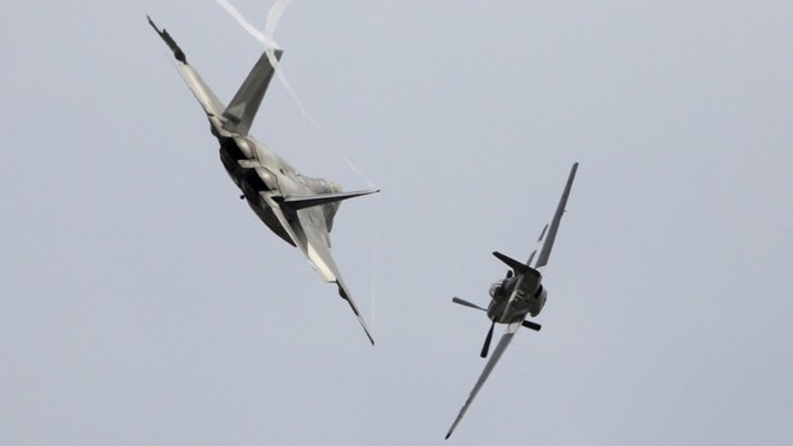 FILE: September 27, 2015: A U.S. Air Force P-51 Mustang and an F-22 Raptor fighter jet at the California International Airshow in Salinas, Calif.