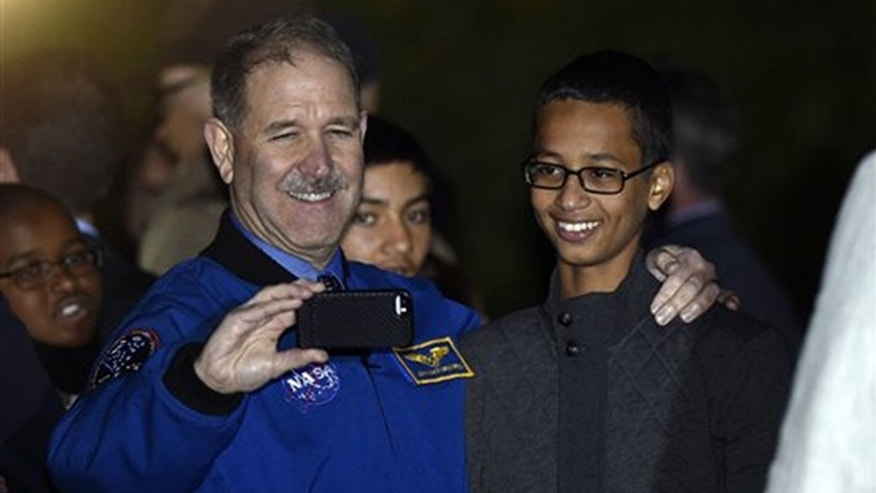 John M. Grunsfeld, left, NASA';s Associate Administrator for the Science Mission Directorate, takes a photo with Ahmed Mohamed, right, the Texas teenager arrested after a homemade clock he brought to school was mistaken for a bomb during the second-ever White House Astronomy Night on the South Lawn of the White House in Washington, Monday, Oct. 19, 2015. (AP Photo/Susan Walsh)