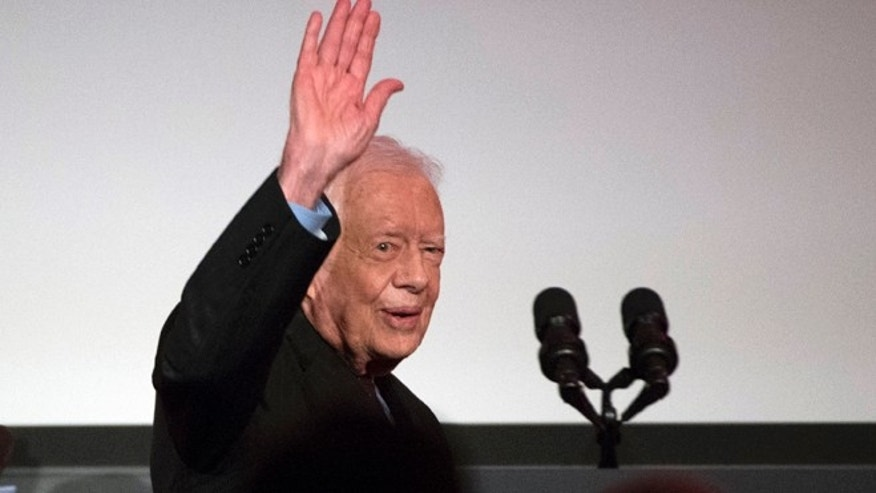 Oct. 20, 2015: Former President Jimmy Carter waves after participating in a tribute to former Vice President Walter Mondale in Washington. (AP)